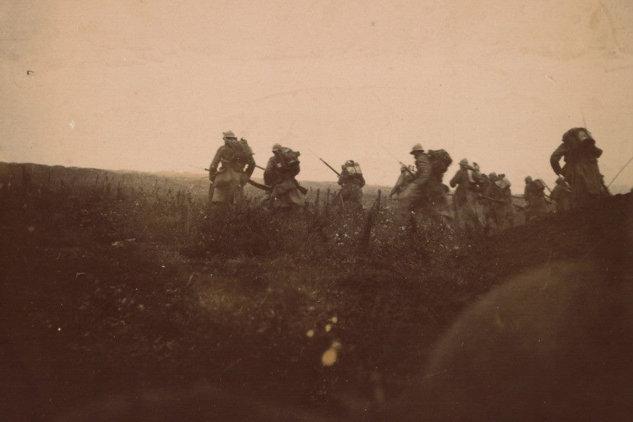 An actual combat photograph of troops going into the attack in Champagne, fall 1915.