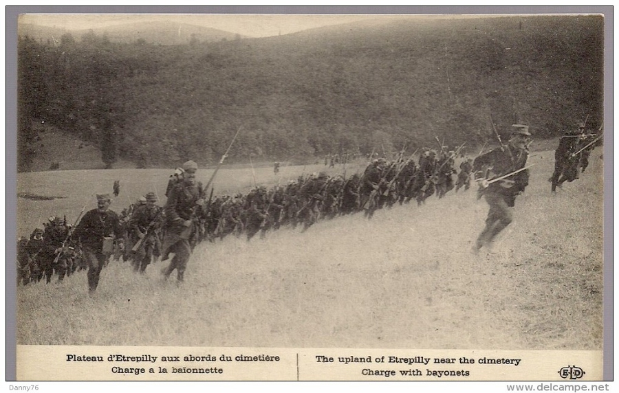 Although the photo is staged for before the war, the depiction of a 1914 bayonet attack is accurate.