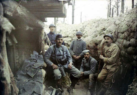 Soldiers and officers sitting outside a shelter, 1915.