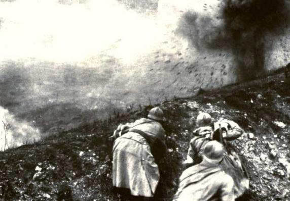 Soldiers duck as a shell impacts on the other side of an embankment, Verdun, 1916. (Note: this was actually from a filming done in the 1920s)