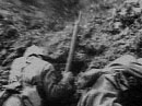 Soldiers take cover from an exploding shell.