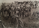 Cyclists and cavalrymen waiting to transmit orders in March 1918.