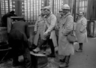 Soldiers on furlough in Paris, getting shoe shines.