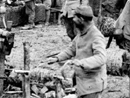 A group of territorials prepares barbed-wire bundles to be carried up to the front.