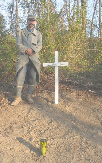 Sgt. Contamine stands beside the unit's newly erected memorial to the French soldiers of the Great War. The cross is inscribed: