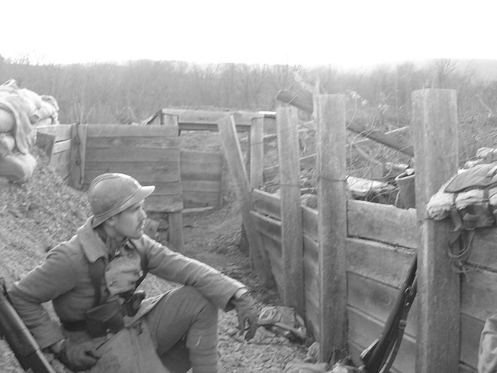 Sdt. Schech rests in the trench, April 2005.