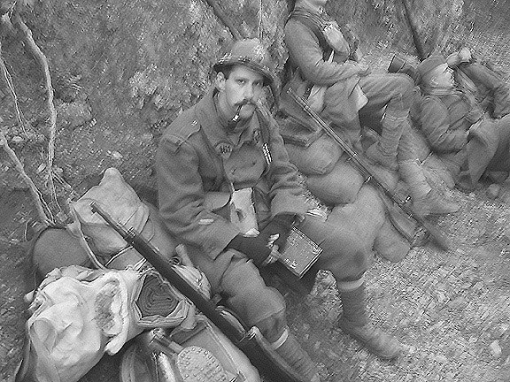 Sgt. Contamine with his burden beside him. It is both a curse and a blessing, November 2005.