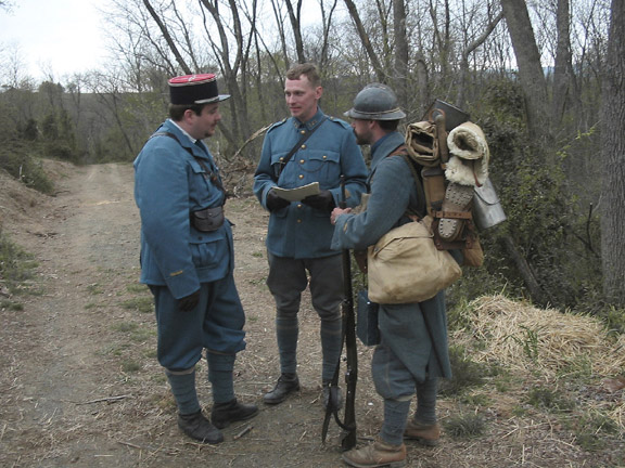 Sgt. Contamine reporting the status of the unit to Capt. William and Lt. Hauser from Battalion staff before heading up to the line, April 2006.