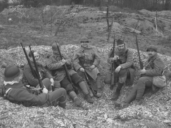 Waiting for orders in a shell-hole, April 2006. From left to right: Sdt. Desjardins, Cpl. Picard, Sdts. Martin, Fagot, Marino, Convard.