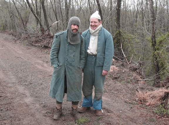 Sgt. Contamine and Cpl. Picard with sore-backs and soggy clothes, April 2006.