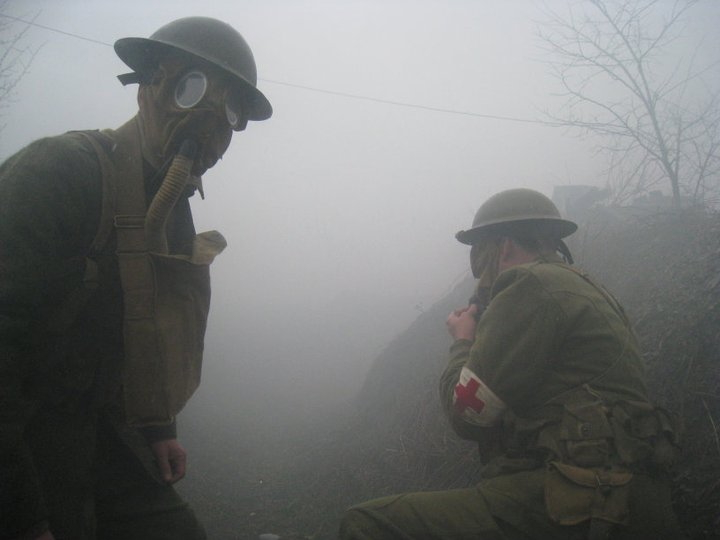 Two American medics in an attack in a foggy and smoky conquered German trench, April 2011.