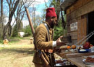 A tirailleur shops for items at the Co-operative du Bataillon Francais. Newville, April 2013.