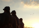 A formation of planes flies over a dawn formation of the Allied battalion. Newville, November 2013.